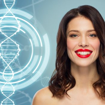 A young woman cropped in smiling next to a genetics symbol